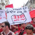 Sunday March 20 marked an important event in the history of trade unionism in Israel. The leadership assembly of the Social Workers' Union (SWU), which organizes some 10,000 public sector social workers, rejected the Histadrut's offer to sign a collective agreement. Instead, a majority of 14 to 11 decided to continue the strike which has been going on for 16 days already. The leadership assembly, which lasted nine hours, was called by the union's Secretary-General Itzhak Perry and Histadrut Chairman Ofer Eini after they had reached a draft agreement which would have improved wages to a certain extent. However, according to many social workers, including some in the union's leadership, the agreement was full of holes and opposition to the agreement soon became militant. In the five days leading to the assembly, thousands of social workers demonstrated daily in front of the Histadrut building against the agreement.